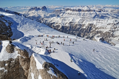 MARMOLADA, ITALY - NOVEMBER 01: Skiers enjoy the first ski day of the year as Marmolada ski area of Italian Dolomities open its ski-trucks on November 01, 2010 in Marmolada, Italy.  photo
