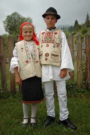 ethnography: GHIMES, ROMANIA - .JUNE 3: Children in traditional clothes participate at festivities during a wedding. Folklore and traditions are well kept in Hungarian communities around Transylvania. June 3, 2005 in Ghimes, Romania Editorial