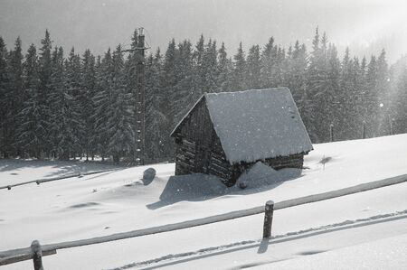 Snow covered mountain holiday house at winter photo