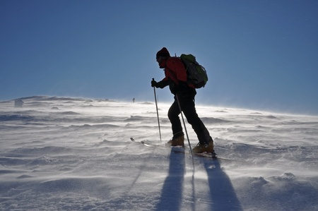 Alone alpine touring skier photo