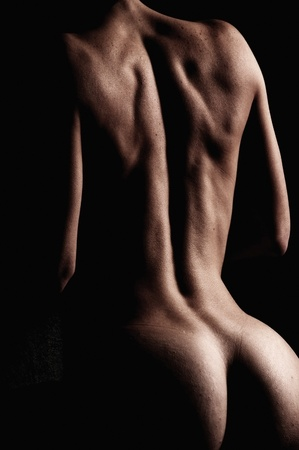 Cul �rotique de la jeune femme sur fond sombre Banque d'images - 12160876
