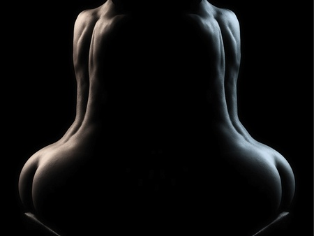Sensual body of young woman over dark background  in mirror Stock Photo