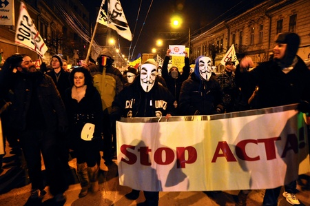 CLUJ NAPOCA – FEBRUARY 11: Hundreds of people protest against ACTA, against web piracy treaty, and the government in Cluj Napoca, on February 11, 2012 in Cluj Napoca, Romania Stock Photo - 12257752
