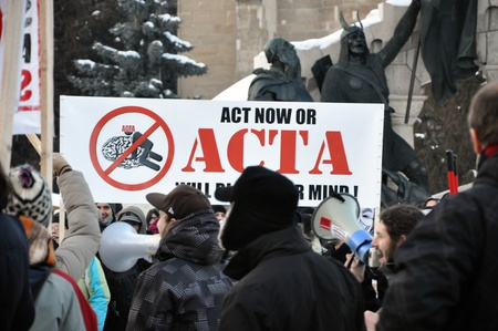 CLUJ NAPOCA – FEBRUARY 11: Hundreds of people protest against ACTA, against web piracy treaty, and the government in Cluj Napoca, on February 11, 2012 in Cluj Napoca, Romania Stock Photo - 12257730