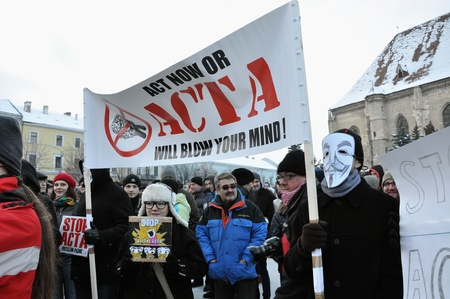 CLUJ NAPOCA � FEBRUARY 11: Hundreds of people protest against ACTA, against web piracy treaty, and the government in Cluj Napoca, on February 11, 2012 in Cluj Napoca, Romania Stock Photo - 12257715