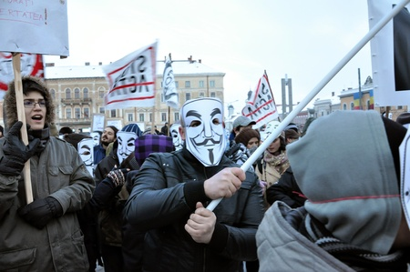 CLUJ NAPOCA � FEBRUARY 11: Hundreds of people protest against ACTA, against web piracy treaty, and the government in Cluj Napoca, on February 11, 2012 in Cluj Napoca, Romania Stock Photo - 12257716