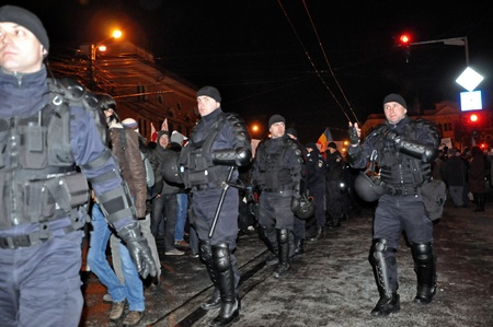 CLUJ NAPOCA - FEBRUARY 11: Special unit policemans controlling the street during a protest against ACTA, the web piracy treaty, and the government on February 11, 2012 in Cluj Napoca, Romania Stock Photo - 12257748