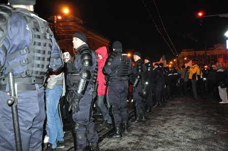 CLUJ NAPOCA - FEBRUARY 11: Special unit policemans controlling the street during a protest against ACTA, the web piracy treaty, and the government on February 11, 2012 in Cluj Napoca, Romania Stock Photo - 12257751