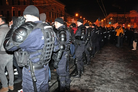 CLUJ NAPOCA - FEBRUARY 11: Special unit policemans controlling the street during a protest against ACTA, the web piracy treaty, and the government on February 11, 2012 in Cluj Napoca, Romania Stock Photo - 12257756