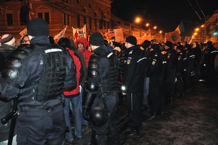 CLUJ NAPOCA - FEBRUARY 11: Special unit policemans controlling the street during a protest against ACTA, the web piracy treaty, and the government on February 11, 2012 in Cluj Napoca, Romania