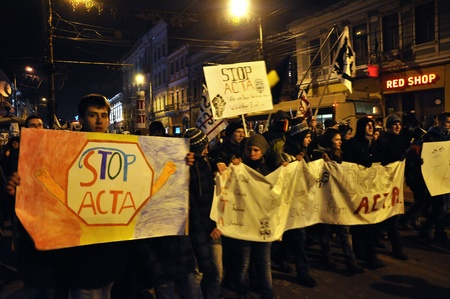 CLUJ NAPOCA – FEBRUARY 11: Hundreds of people protest against ACTA, against web piracy treaty, and the government in Cluj Napoca, on February 11, 2012 in Cluj Napoca, Romania Stock Photo - 12257741