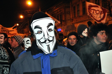 CLUJ NAPOCA � FEBRUARY 11: Hundreds of people protest against ACTA, against web piracy treaty, and the government in Cluj Napoca, on February 11, 2012 in Cluj Napoca, Romania Stock Photo - 12257742
