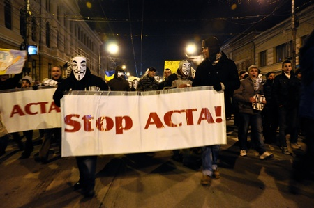 CLUJ NAPOCA � FEBRUARY 11: Hundreds of people protest against ACTA, against web piracy treaty, and the government in Cluj Napoca, on February 11, 2012 in Cluj Napoca, Romania Stock Photo - 12257739