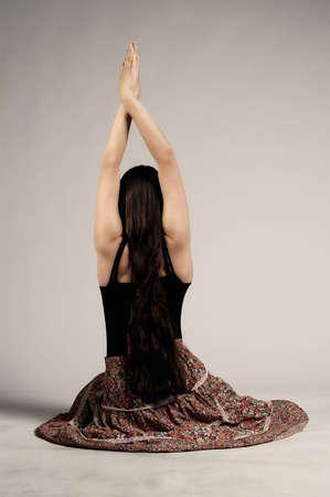 Hippie girl doing yoga exercise  photo
