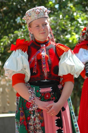 SANCRAIU, ROMANIA � CCA. JULY, 2005: Young dancers in traditional clothe participate at a wedding. Folklore is well kept in Hungarian communities in  Transylvania. Cca July, 2005 in Sancraiu, Romania
