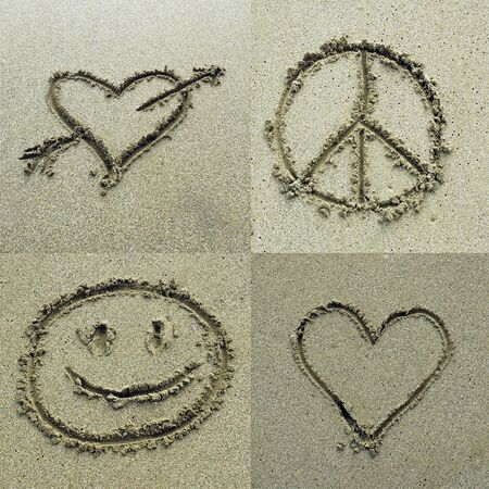 Different signs drawn on sand photo