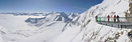 KITZSTEINHORN – CCA. MARCH: Panorama with unidentified skiers who are enjoying the last ski week of the season in Kitzsteinhorn, in March, 2012 in Kitzsteinhorn, Austria