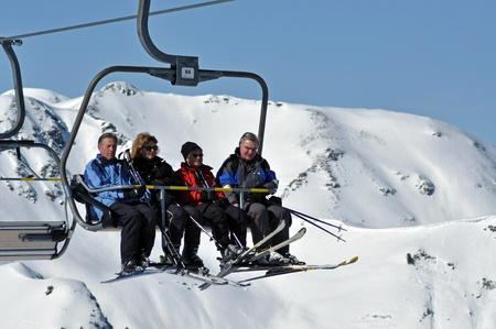 ZELL AM SEE, CCA. MARCH: Unidentified skiers going up with a ski lift and enjoying the last ski week of the season in March, 2012 in Zell am See, Austria  Stock Photo - 12618300