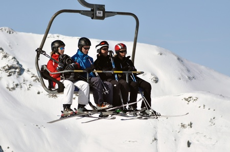 ZELL AM SEE, CCA. MARCH: Unidentified skiers going up with a ski lift and enjoying the last ski week of the season in March, 2012 in Zell am See, Austria  Stock Photo - 12618299