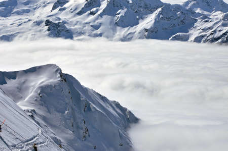 Winter view from Kitzsteinhorn peak ski resort, clouds down in the valley, Austrian Alps Stock Photo - 12669307