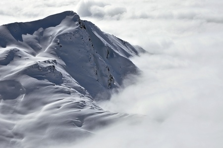 Peaks above clouds, winter in the Austrian Alps Stock Photo - 12669176