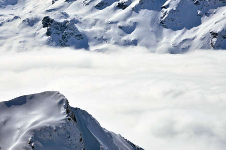 Clouds and fog above, beautiful sunny winter landscape in the Austrian Alps photo