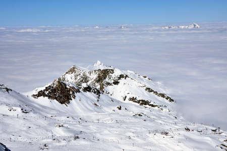 kitzsteinhorn: Clouds and fog above, beautiful sunny winter landscape in the Austrian Alps. Kitzsteinhorn, Austria Stock Photo