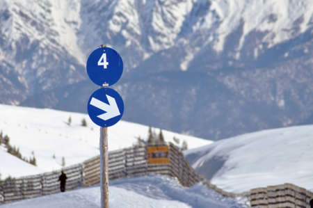 A blue ski slope with number 4 in the Austrian Alps photo