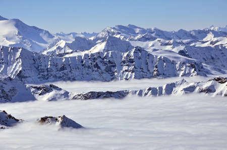 Peaks above clouds, winter in the Austrian Alps. View from Kitzsteinhorn, Kaprun. Stock Photo - 12849968