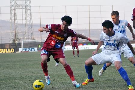 rui: CLUJ-NAPOCA, ROMANIA – MARCH 17: Rui Pedro (in red) in action at a Romanian National Championship soccer game CFR Cluj vs. Pandurii Targu Jiu, March 17, 2012 in Cluj-Napoca, Romania