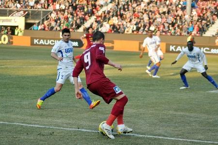 cfr cluj: CLUJ-NAPOCA, ROMANIA – MARCH 17: P. Kapetanos (in red) in action at a Romanian National Championship soccer game CFR Cluj vs. Pandurii Targu Jiu, March 17, 2012 in Cluj-Napoca, Romania
