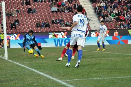 CLUJ-NAPOCA, ROMANIA – MARCH 17: P. Goalkeeper Pedro Mingote in action at a Romanian National Championship soccer game CFR Cluj vs. Pandurii Targu Jiu, March 17, 2012 in Cluj-N, Romania