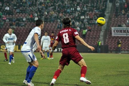 cfr cluj: CLUJ-NAPOCA, ROMANIA – MARCH 17: Vranjes S. (in red) in action at a Romanian National Championship soccer game CFR Cluj vs. Pandurii Targu Jiu, March 17, 2012 in Cluj-N., Romania