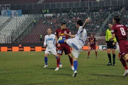 cfr cluj: CLUJ-NAPOCA, ROMANIA – MARCH 17: Ronny C. (L) and B. Ungurusan (R) in action at a Romanian National Championship soccer game CFR Cluj vs. Pandurii Targu Jiu, March 17, 2012 in Cluj-N., Romania