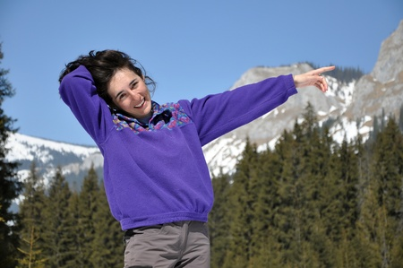 Portrait of a happy young woman at winter, in the mountains Stock Photo - 12850077