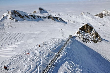 Skier going down the mountain on a slope in a sunny day  Kitzsteinhorn, Austria photo