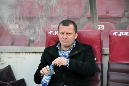 galati: CLUJ-NAPOCA, ROMANIA - MARCH 26: Coach D. Munteanu at a Romanian National Championship soccer game CFR Cluj vs. Otelul Galati, March 26, 2012 in Cluj-Napoca, Romania