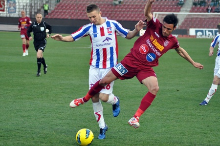 galati: CLUJ-NAPOCA, ROMANIA – MARCH 26: M. Camora (in red) in action at a Romanian National Championship soccer game CFR Cluj vs. Otelul Galati, March 26, 2012 in Cluj-Napoca, Romania