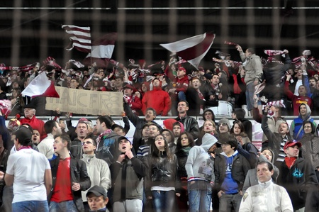 galati: CLUJ NAPOCA, ROMANIA – MARCH 26: FC CFR Cluj team supporters shows their support during a game in League 1 against FC Otelul Galati on March 26, 2012 in Cluj Napoca, Romania