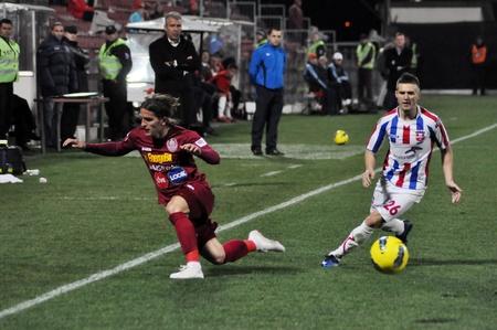galati: CLUJ-NAPOCA, ROMANIA – MARCH 26: S. Vranjes (in red) in action at a Romanian National Championship soccer game CFR Cluj vs. Otelul Galati, March 26, 2012 in Cluj-Napoca, Romania