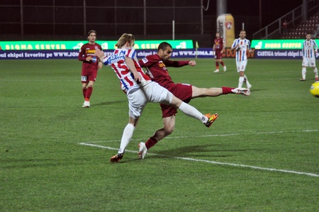 galati: CLUJ-NAPOCA, ROMANIA – MARCH 26: V. Maftei (in red) in action at a Romanian National Championship soccer game CFR Cluj vs. Otelul Galati, March 26, 2012 in Cluj-Napoca, Romania