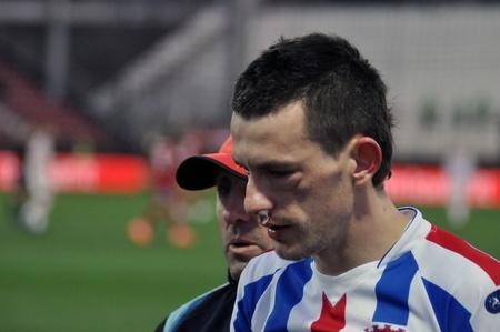 cfr cluj: CLUJ-NAPOCA, ROMANIA – MARCH 26: A. Salageanu suffered an accident at a Romanian National Championship soccer game CFR Cluj vs. Otelul Galati, March 26, 2012 in Cluj-Napoca, Romania Editorial