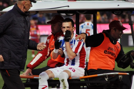 galati: CLUJ-NAPOCA, ROMANIA – MARCH 26: A. Salageanu suffered an accident at a Romanian National Championship soccer game CFR Cluj vs. Otelul Galati, March 26, 2012 in Cluj-Napoca, Romania