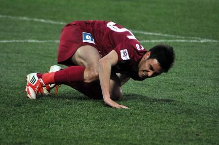 galati: CLUJ-NAPOCA, ROMANIA – MARCH 26: M. Camora suffered an accident at a Romanian National Championship soccer game CFR Cluj vs. Otelul Galati, March 26, 2012 in Cluj-N, Romania
