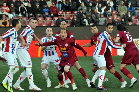 galati: CLUJ-NAPOCA, ROMANIA – MARCH 26: P. Kapetanos (in red) in action at a Romanian National Championship soccer game CFR Cluj vs. Otelul Galati, March 26, 2012 in Cluj-Napoca, Romania Editorial