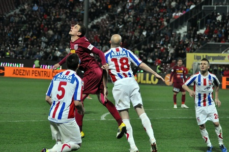 CLUJ-NAPOCA, ROMANIA – MARCH 26: L. Ganea (red) and S. Viorel (white) in action at a Romanian National Championship soccer game CFR Cluj vs. Otelul Galati, March 26, 2012 in Cluj-N, Romania Redakční
