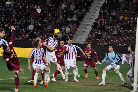galati: CLUJ-NAPOCA, ROMANIA – MARCH 26: I. Viorel (in white) in action at a Romanian National Championship soccer game CFR Cluj vs. Otelul Galati, March 26, 2012 in Cluj-Napoca, Romania Editorial