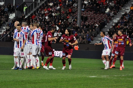 galati: CLUJ-NAPOCA, ROMANIA – MARCH 26: Soccer players in action at a Romanian National Championship football game CFR Cluj vs. Otelul Galati, March 26, 2012 in Cluj-N, Romania Editorial