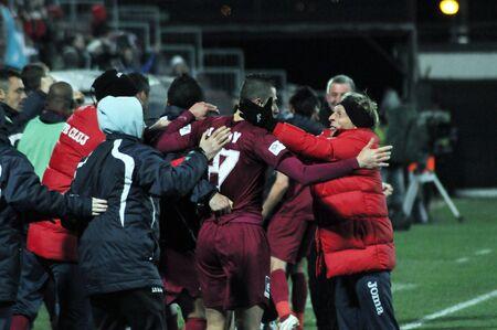 CLUJ NAPOCA, ROMANIA – MARCH 26: FC CFR Cluj players celebrate the victory against FC Otelul Galati, final score 2:0 on March 26, 2012 in Cluj N, Romania