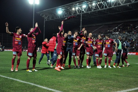 galati: CLUJ NAPOCA, ROMANIA – MARCH 26: FC CFR Cluj players celebrate the victory against FC Otelul Galati, final score 2:0 on March 26, 2012 in Cluj N, Romania